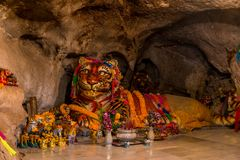 Large tiger sculpture with religious attributes in a tiger cave. In Krabi, Thailand Stock Photo