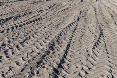 Large Tire Tracks in Sand Stock Photo