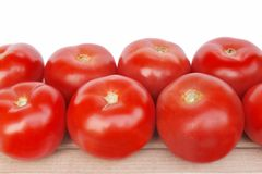 Large tomatoes on the wooden board Royalty Free Stock Images
