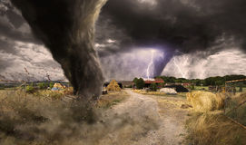 Large Tornado disaster. View of a large tornado destroying a barn