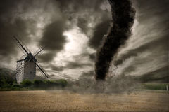 Large tornado over a wind mill Stock Photography
