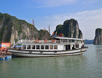 Large Tourist Junk Boat without sail docking at Fishing Village in Halong Bay Stock Images