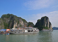 Large Tourist Junk Boats docking at Fishing Village in Halong Bay Stock Image