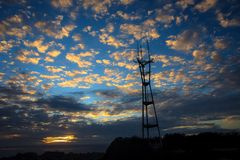Large tower against a sky. Radio tower during a sunset Stock Photography