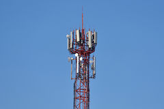 Large tower with antennas for communication of cell phones Stock Image