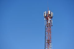 Large tower with antennas for communication of cell phones Stock Photos