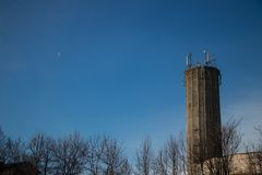 Large tower and little moon. Scene royalty free stock images