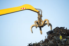 Large tracked excavator working a steel pile Royalty Free Stock Photos