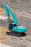 A large trackhoe moving rock Royalty Free Stock Image