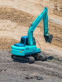 A large trackhoe moving rock Royalty Free Stock Images