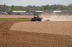 Large Tractor Harrowing a Field Royalty Free Stock Photography
