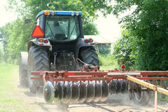 Large tractor pulling discs Royalty Free Stock Photos