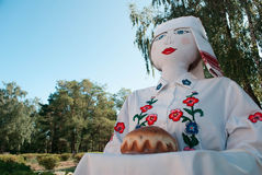 Large traditional doll greets guests with a loaf, stock images