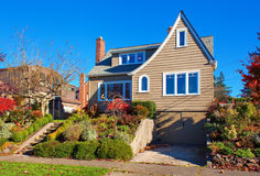 Large traditional house with shrubbery. Stock Photo