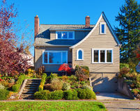 Large traditional house with shrubbery. Royalty Free Stock Photo