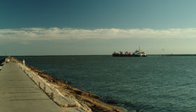 Large Transport Ship moving out to sea Royalty Free Stock Images