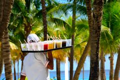 Large tray of drinks being delivered in caribbean holiday resort Stock Image