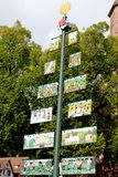 Large tree shaped signpost with colorful pictures Royalty Free Stock Photo
