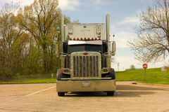 A large truck with cargo at a rest area. A powerful semi  used for transporting heavy loads Royalty Free Stock Photos