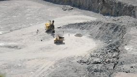 Large truck driving on a granite quarry. Top view stock video