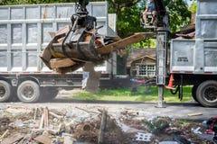 Large truck picking up trash and debris outside of Houston neighborhood royalty free stock photos