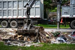 Large truck picking up trash and debris outside of Houston neighborhood stock images