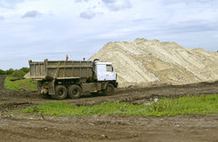 Large truck running in the quarry for the extraction of sand Royalty Free Stock Photos