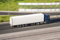 Large truck with a trailer on the highway at a speed that moves along the asphalt, view from above. Large truck with a trailer on the highway at a speed that Royalty Free Stock Photos