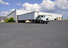 Large truck at unloading dock stock photography
