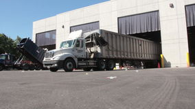 Large truck unloading trash 1 of 2. Environmental Recycling and Trash scene stock video