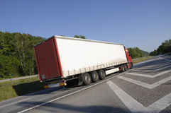 Large truck zooming past Royalty Free Stock Image