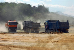 Large trucks at construction site Royalty Free Stock Images