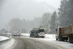 Large trucks fight a winter storm Stock Photo