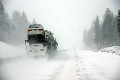 Large trucks fight a winter storm Stock Photography