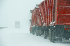 Large trucks fight a winter storm Royalty Free Stock Photography