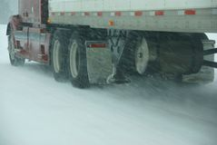 Large trucks fight a winter storm Stock Photos