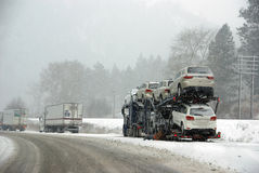 Large trucks fight a winter storm Stock Image