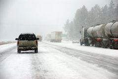 Large trucks fight a winter storm Royalty Free Stock Images