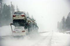 Large trucks fight a winter storm Stock Photo