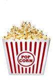 Large Tub Of Delicious Buttery Popcorn. Vertical shot of a large tub of delicious and buttery popcorn that's isolated on a white background Stock Photography