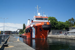 Large tugboat firefighting ship departs main lock at Ballard Loc Royalty Free Stock Photo