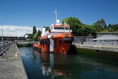 Large tugboat firefighting ship lifted at Ballard Locks Stock Photos