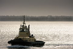 Large Tugboat at sea in late afternoon. Large ocean tugboat at sea in late afternoon light Royalty Free Stock Photos