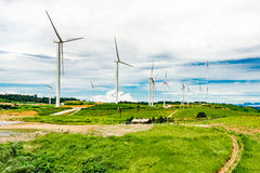 wind turbine  A large And pasture located on the mountain. Stock Photo
