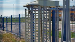 Large turnstile at the entrance to the territory. Protection against intrusion to the private area. Camera shoots