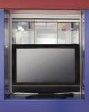 Large TV on shelf Stock Photo