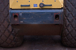 LARGE TYRES OF HEAVY ROAD ROLLER Stock Image