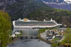 Cruise ship in Fjords. Large UK cruise ship in the heart of the Norwegian Fjords Royalty Free Stock Images