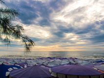 Large umbrella crowded along the beach. Large umbrella crowded along Cha-Am beach Stock Image