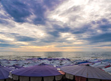 Large umbrella crowded along the beach. Large umbrella crowded along Cha-Am beach Stock Photo